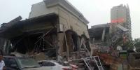 湖北襄阳大楼垮塌 原计划拆迁却垮塌了或因工作人员失误/图 - 浙江频道