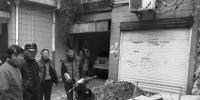 2楼大姐的反对让邻居和工人们一筹莫展。 - 浙江新闻网