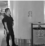 杭州东站不少人在禁烟标识下抽烟。 - 浙江新闻网